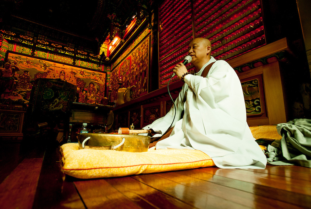 A monk leads prayers at Sunkwang Temple in Busan, South Korea, May 25, 2012.