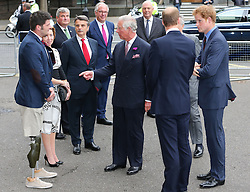 Image licensed to i-Images Picture Agency. 08/07/2014. London, United Kingdom. The Prince of Wales accompanied by the Duke of Cambridge and Prince Harry  talk to wounded serviceman Cpt David Henson as they arrive at the Business in the Community Awards Gala in London. Picture by Stephen Lock / i-Images
