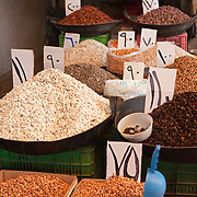 Grains and pulses with arabic signs in an Aleppo market, Syria