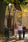 Newport, RI - three girls walk though Washington square park with fall colors.