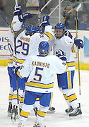 Lake Superior State's Zach Trotman (right) gets congratulated by linemates after scoring the Lakers third period goal against Notre Dame Saturday night in Sault Ste. Marie.