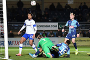 Tranmere Rovers goalkeeper Scott Davies (1) makes an important save  under pressure from Wycombe Wanderers defender Jamie Mascoll (15) during the The FA Cup match between Wycombe Wanderers and Tranmere Rovers at Adams Park, High Wycombe, England on 20 November 2019.
