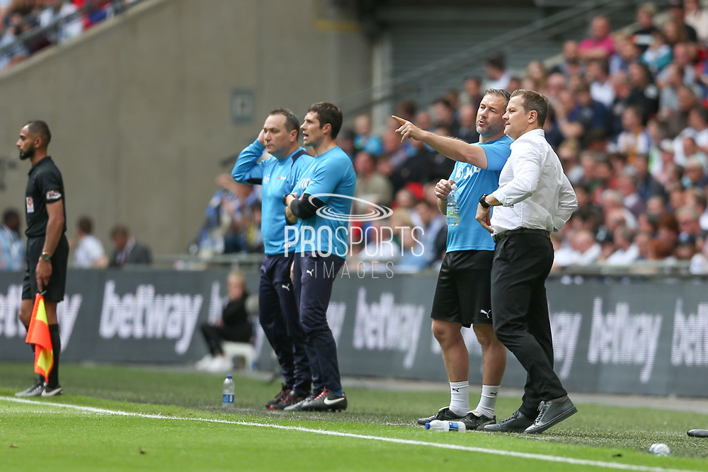 Forest Green Rovers assistant manager, Scott Lindsey and Forest Green Rovers manager, Mark Cooper discuss tactics in the technical area during the Vanarama National League Play Off Final match between Tranmere Rovers and Forest Green Rovers at Wembley Stadium, London, England on 14 May 2017. Photo by Shane Healey.