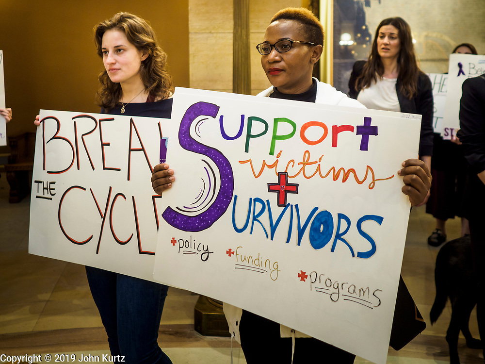 27 MARCH 2019 - ST PAUL, MN, USA: KAY SHEEHAN, left, and BEATRICE LAIZER, both from St. Paul, MN, and members of Women's Advocates, during a rally in support of the survivors of domestic violence. About 200 people came to the Minnesota State Capitol to rally for two bills in the Minnesota legislature. HF464 would invest in intervention programming for the perpetrators of domestic violence and HF479 supports state funding for domestic violence prevention in under served communities.   PHOTO BY JACK KURTZ