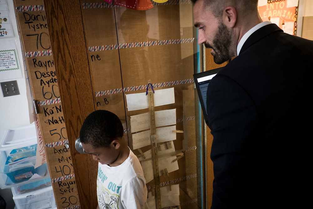 Eric Christopher, Leap ELA Instructional Coach at Turner Elementary School in Washington, D.C., talks to a student as he leaves a classroom on Wednesday, May 4, 2017.
