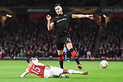 Arsenal Midfielder Ainsley Maitland-Niles (15) tackles Rennes Ramy Bensabaini (15) during the Europa League round of 16, leg 2 of 2 match between Arsenal and Rennes at the Emirates Stadium, London, England on 14 March 2019.