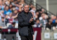 Football - 2018 / 2019 Premier League - West Ham United vs. Manchester United<br /> <br /> Jose Mourinho, mamager of Manchester United, encourages his team on at the London Stadium<br /> <br /> COLORSPORT/DANIEL BEARHAM