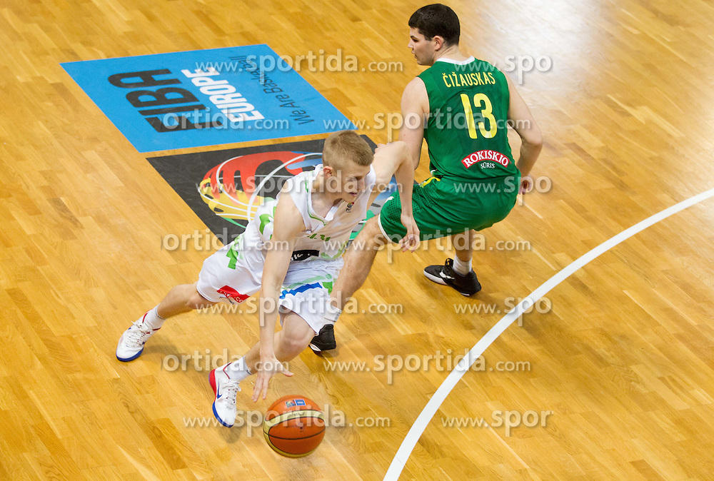 Luka Rupnik of Slovenia vs Vytenis Cizauskas of Lithuania during basketball match between National teams of Slovenia and Lithuania in First Round of U20 Men European Championship Slovenia 2012, on July 14, 2012 in Domzale, Slovenia.  (Photo by Vid Ponikvar / Sportida.com)