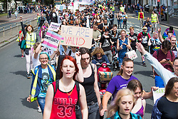 © Licensed to London News Pictures. 22/07/2017. Brighton, UK. Members of the LGBT community take part in the Brighton Trans Pride 2017 parade. several thousand participants attending the yearly event in support of the Trans community in the UK. Photo credit: Hugo Michiels/LNP
