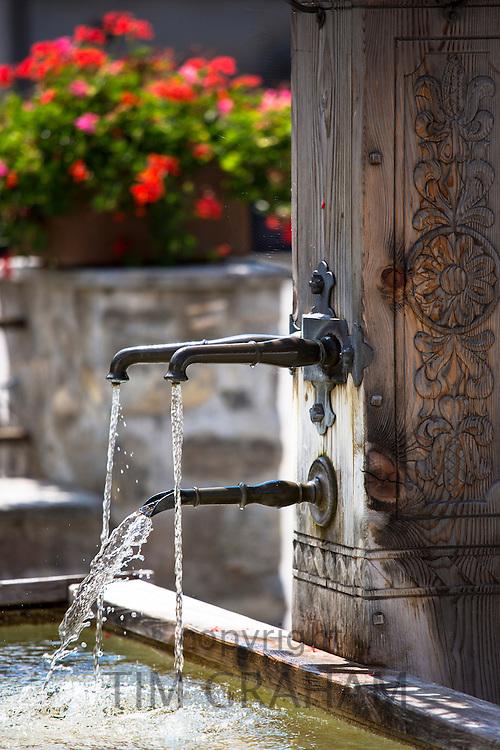 Tap and water fountain in Serneus near Klosters in Graubunden region, Switzerland