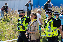 West Hyde, UK. 14th September, 2020. Hertfordshire Police arrest an environmental activist from HS2 Rebellion who, together with another activist, had used a lock-on arm tube to block a gate to the South Portal site for the HS2 high-speed rail link. Anti-HS2 activists blocked two gates to the same works site for the controversial £106bn rail line, one remaining closed for over six hours and another for over twelve hours.