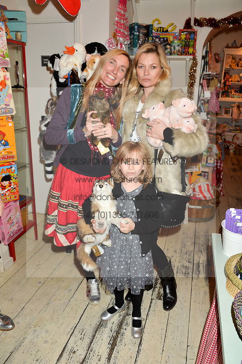 HONEY BOWDREY,her daughter DOMINO with KATE MOSS at a promotional party for the A Girl For All Time doll held at HoneyJam, 2 Blenheim Crescent, London on 5th December 2015.