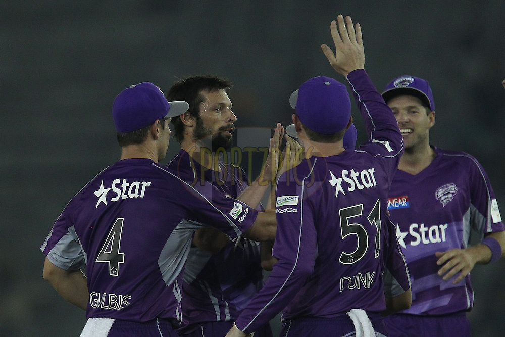 Ben HILFENHAUS of the Hobart Hurricanes celebrates the wicket ofDavid MILLER of the Kings XI Punjab  during match 2 of the Oppo Champions League Twenty20 between the Kings XI Punjab and the Hobart Hurricanes held at the Punjab Cricket Association Stadium, Mohali, India on the 18th September 2014<br /> <br /> Photo by:  Ron Gaunt / Sportzpics/ CLT20<br /> <br /> <br /> Image use is subject to the terms and conditions as laid out by the BCCI/ CLT20.  The terms and conditions can be downloaded here:<br /> <br /> http://sportzpics.photoshelter.com/gallery/CLT20-Image-Terms-and-Conditions-2014/G0000IfNJn535VPU/C0000QhhKadWcjYs