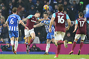 West Ham United striker Jordan Hugill (12) battles in the air with Brighton and Hove Albion defender Shane Duffy (22) during the Premier League match between Brighton and Hove Albion and West Ham United at the American Express Community Stadium, Brighton and Hove, England on 3 February 2018. Picture by Phil Duncan.