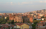 View of the city of Bergama, site of the ancient city of Pergamon, with the ruins of the Red Basilica, Izmir, Turkey. The Red Basilica or Kizil Avlu is part of a Roman temple complex from the time of Emperor Hadrian, 2nd century AD, used to worship the Egyptian gods and subsequently converted to a Christian church by the Byzantines. The North Rotunda in the foreground is now in use as a mosque. Picture by Manuel Cohen