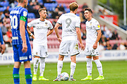 Leeds United defender Barry Douglas (3) and Leeds United midfielder Pablo Hernandez (19) in action during the EFL Sky Bet Championship match between Wigan Athletic and Leeds United at the DW Stadium, Wigan, England on 17 August 2019.