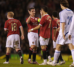 Manchester, England - Tuesday, March 13, 2007: Manchester United's Christiano Ronaldo celebrates scoring the third goal from a free kick against Europe XI, with his team-mate captain Gary Neville, during the UEFA Celebration Match at Old Trafford. (Pic by David Rawcliffe/Propaganda)