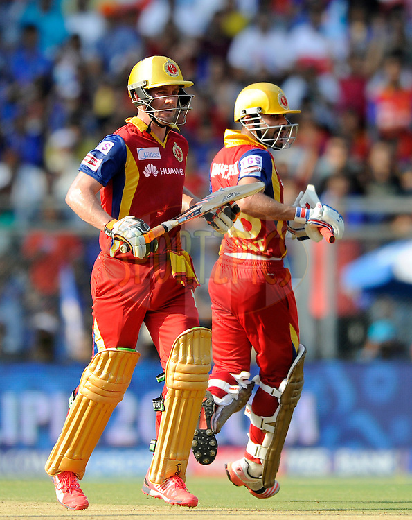 AB De Villiers of Royal Challengers Bangalore and Virat Kohli captain of Royal Challengers Bangalore run between the wickets during match 46 of the Pepsi IPL 2015 (Indian Premier League) between The Mumbai Indians and The Royal Challengers Bangalore held at the Wankhede Stadium in Mumbai, India on the 10th May 2015.<br /> <br /> Photo by:  Pal Pillai / SPORTZPICS / IPL