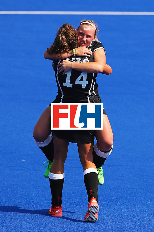 RIO DE JANEIRO, BRAZIL - AUGUST 19:  Janne Muller-Wieland #14 and Nike Lorenz #4 of Germany celebrate defeating New Zealand 2-1 in the Women's Bronze Medal Match on Day 14 of the Rio 2016 Olympic Games at the Olympic Hockey Centre on August 19, 2016 in Rio de Janeiro, Brazil.  (Photo by Tom Pennington/Getty Images)