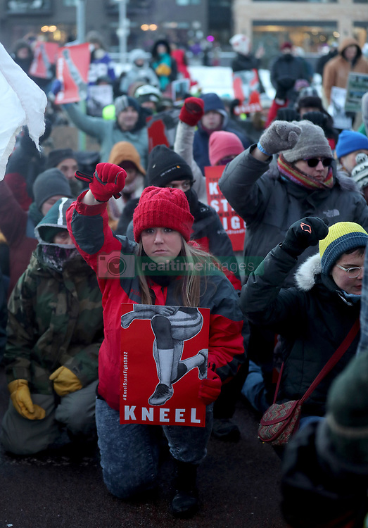 February 4, 2018 - Minneapolis, MN, USA - Protesters take a knee outside U.S. Bank Stadium at the conclusion of a march outside the Super Bowl on Sunday, Feb. 4, 2018, in Minneapolis, Minn. (Credit Image: © David Joles/TNS via ZUMA Wire)