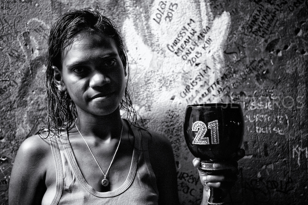"Chrissy holding a birthday cup which has the number 21 on it. Chrissy turned 21 years old, her mum Elaine Wiggan said to me; ""She is a loving mum and does not drink, she stays home and looks after her two kids."" Broome, Western Australia. ©Ingetje Tadros/Diimex"
