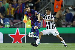 (L-R) Lionel Messi of FC Barcelona, Paulo Dybala of Juventus FC during the UEFA Champions League group D match between FC Barcelona and Juventus FC  on September 12, 2017  at the Camp Nou stadium in Barcelona, Spain.