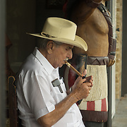 JUNE 9, 2016---MIAMI, FLORIDA<br /> Pedro Bello, 88, lights one of the many cigars he will smoke in one day. He claims to smoke up to 20 cigars per day starting early in the morning. He sits in front of the cigar shop he owns with his son, Cuba Tobacco Cigar Co.,  in the heart of Miami's Little Havana neighborhood.<br /> (Photo by Angel Valentin/Freelance)