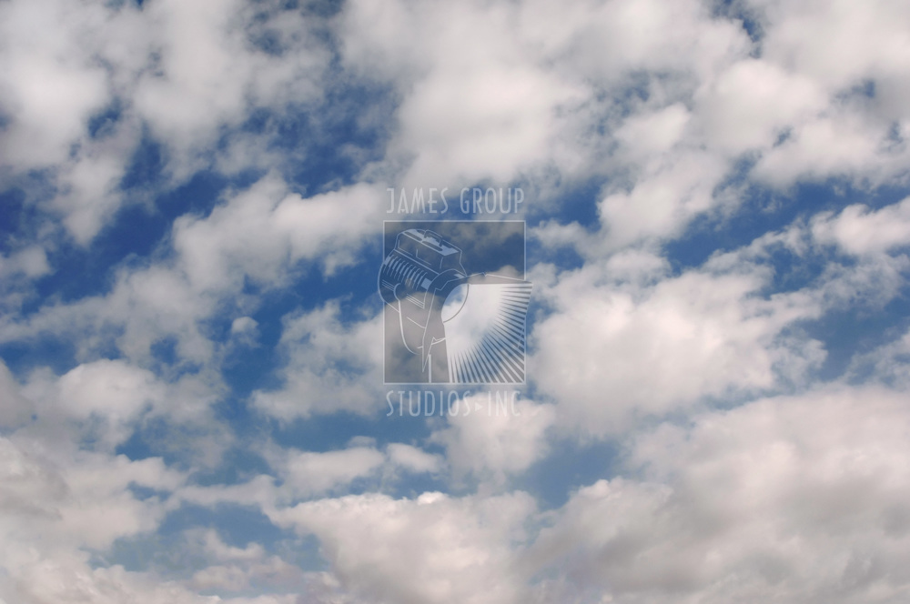 partly cloudy blue sky with full frame cloud coverage