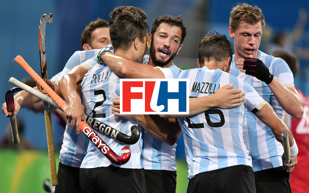 Argentina's Gonzalo Peillat (2nd L) is congratulated by teammates after scoring their third goal during the men's Gold medal field hockey Belgium vs Argentina match of the Rio 2016 Olympics Games at the Olympic Hockey Centre in Rio de Janeiro on August 18, 2016. / AFP / Pascal GUYOT        (Photo credit should read PASCAL GUYOT/AFP/Getty Images)