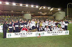 MONACO, FRANCE - Friday, August 24, 2001: Liverpool players celebrate winning the UEFA Super Cup after beating Bayern Munich 3-2 during the UEFA Super Cup Final at the Stade Louis II. L-R: manager Gerard Houllier, coach Sammy Lee, physio Dave Galley, Graham Carter, coach Alex Miller, coach Joe Corrigan, Club Doctor Mark Waller, Stephane Henchoz, Gary Armah, Gary McAllister, Gregory Vignal, Dietmar Hamann, goalkeeper Sander Westerveld, Igor Biscan, goalkeeper Pegguy Arphexad, John Arne Riise, Emile Heskey, Marcus Babbel, Danny Murphy, Sami Hyypia, Steven Gerrard, Jamie Redknapp, Robbie Fowler, Jaques Crovesier, Michael Owen, Jamie Carragher and coach Phil Thompson. (Pic by David Rawcliffe/Propaganda)