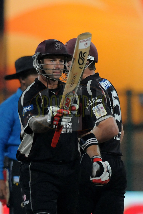 Peter Trego of Somerset celebrates after hitting a half century during match 16 of the NOKIA Champions League T20 ( CLT20 ) between the Royal Challengers Bangalore and Somerset held at the  M.Chinnaswamy Stadium in Bangalore , Karnataka, India on the 3rd October 2011..Photo by Pal Pillai/BCCI/SPORTZPICS