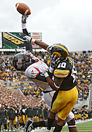 October 03, 2009: Iowa cornerback William Lowe (10) knocks away a pass intended for Arkansas State wide receiver Allen Muse (17) during the second half of the Iowa Hawkeyes' 24-21 win over the Arkansas State Red Wolves at Kinnick Stadium in Iowa City, Iowa on October 03, 2009.
