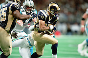 Defensive back Aeneas Williams (35) of the St. Louis Rams gets tackled while returning a turnover during a 48 to 14 win over the Carolina Panthers on 11/11/2001..©Wesley Hitt/NFL Photos
