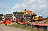 Construction crew backfilling the trench burying the Bayou Bridge Pipeline, next to Melinda Tillies house in Youngsville, Louisiana. <br /> The pipeline was installed about 25 feet from her home on her neighbors land.  There are no federal rules about how close a pipeline can be built next to a home.