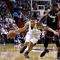 14 March 2011: San Antonio Spurs point guard George Hill (3) drives past Miami Heat shooting guard Dwyane Wade (3) during the Miami Heat 110-80 victory over the San Antonio Spurs at the AmericanAirlines Arena, Miami, Florida, USA.
