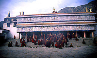 Monks enter Labrung monastery in Xiahe, China.