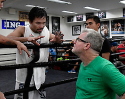 Oct 25, 2016.HOLLYWOOD CA. Manny Pacquiao talks with with is trainer Freddie Roach at the wild card gym  for his upcoming fight with Jessy Vargas Tuesday. The two will fight November 5th at the Thomas & Mac arena in Las Vegas. .Photo by Gene BlevinsLA DailyNewsZumaPress (Credit Image: © Gene Blevins via ZUMA Wire)