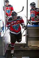KELOWNA, CANADA - DECEMBER 5:  Carter Rigby #11 of the Kelowna Rockets heads to the dressing room after warm up against the Swift Current Broncos at the Kelowna Rockets on December 5, 2012 at Prospera Place in Kelowna, British Columbia, Canada (Photo by Marissa Baecker/Shoot the Breeze) *** Local Caption *** Carter Rigby;