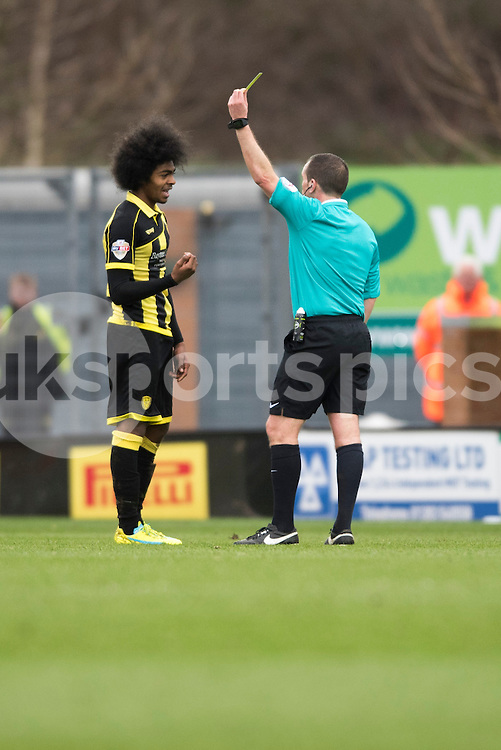 Hamza Choudhury of Burton Albion gets a yellow card during the Sky Bet League 1 match between Burton Albion and Oldham Athletic at the Pirelli Stadium, Burton upon Trent, England on 26 March 2016. Photo by Brandon Griffiths.