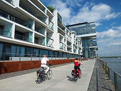 Modern Rheinauhafen property development along Rhine riverbank in Cologne Germany