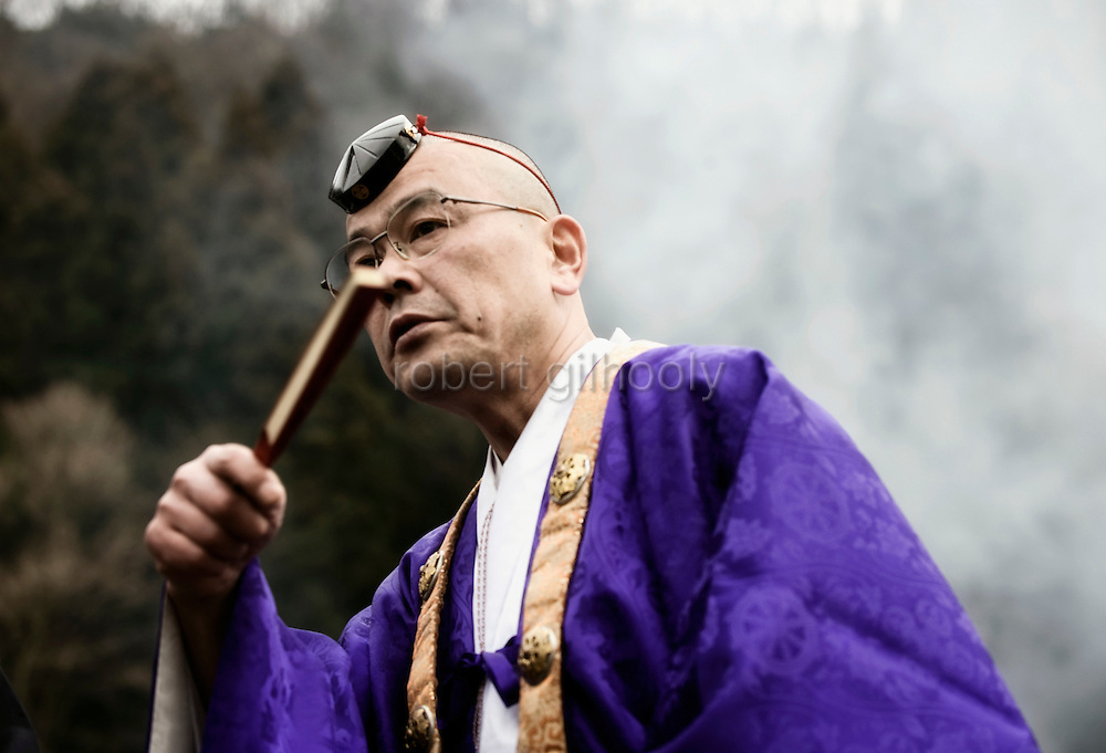 Folding fan in hand, a high-ranked priest of the Shingon sect of Buddhism takes part in the hiwatari fire-walking ceremony in Takao, west of Tokyo, Japan on Sunday 09 March  2009.