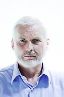 caucasian senior man portrait sullen isolated studio on white background