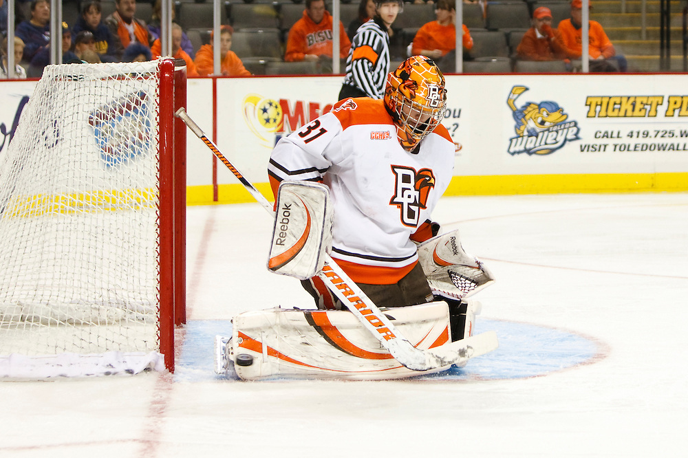 21 November 2009:  BGSU goalie Nick Eno (31) makes a save during the NCCA hockey game between Michigan and the Bowling Green State University at Lucas County Arena in Toledo, Ohio.
