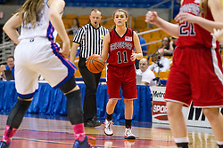 Bridgeport guard Stephanie Alvaro (11) looks for an opening against Fairmont Senior during a first round game at the Charleston Civic Center.