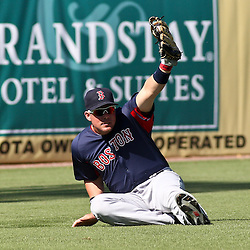 March 11, 2011; Fort Myers, FL, USA; Boston Red Sox left fielder Juan Carlos Linares holds up the ball after making a catch during a spring training exhibition game against the Minnesota Twins at Hammond Stadium.   Mandatory Credit: Derick E. Hingle