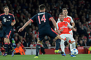 Arsenal striker Alexis Sanchez pass is blocked by Bayern Munich midfielder Xabi Alonso during the Champions League  Group F match between Arsenal and Bayern Munich at the Emirates Stadium, London, England on 20 October 2015. Photo by Alan Franklin.
