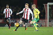 Brentford midfielder Ryan Woods (15) battles for ball with Norwich City forward Alex Pritchard (21) during the EFL Sky Bet Championship match between Brentford and Norwich City at Griffin Park, London, England on 31 December 2016. Photo by Matthew Redman.