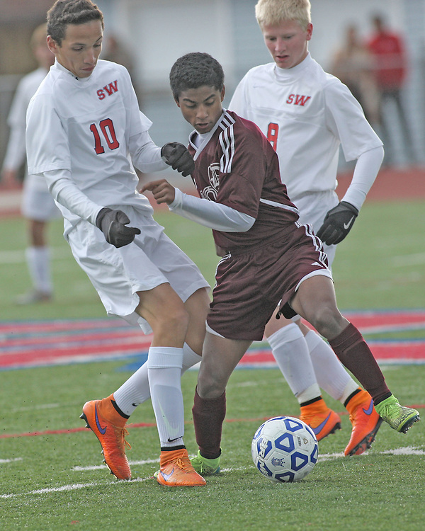 Dunkirk's Antonio Robles battles for the ball with Southwestern's Esteban Diaz and Chase Stevenson during soccer at Southwestern 101415 photo by Mark L. Anderson