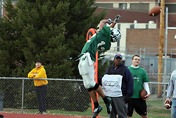 12 November 2011:  The pass being a little high sends the ball through the hands of Joey Driver during an NCAA division 3 football game between the Augustana Vikings and the Illinois Wesleyan Titans in Tucci Stadium on Wilder Field, Bloomington IL