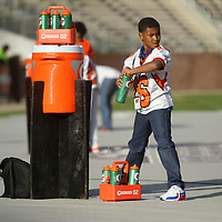 Adam Robison   BUY AT PHOTOS.DJOURNAL.COM<br /> Calhoun City water boy Tazavion Fox fills the water bottles proir to kick off of the Calhoun City and Bay Springs Class 2A Championship game Friday in Starkville.